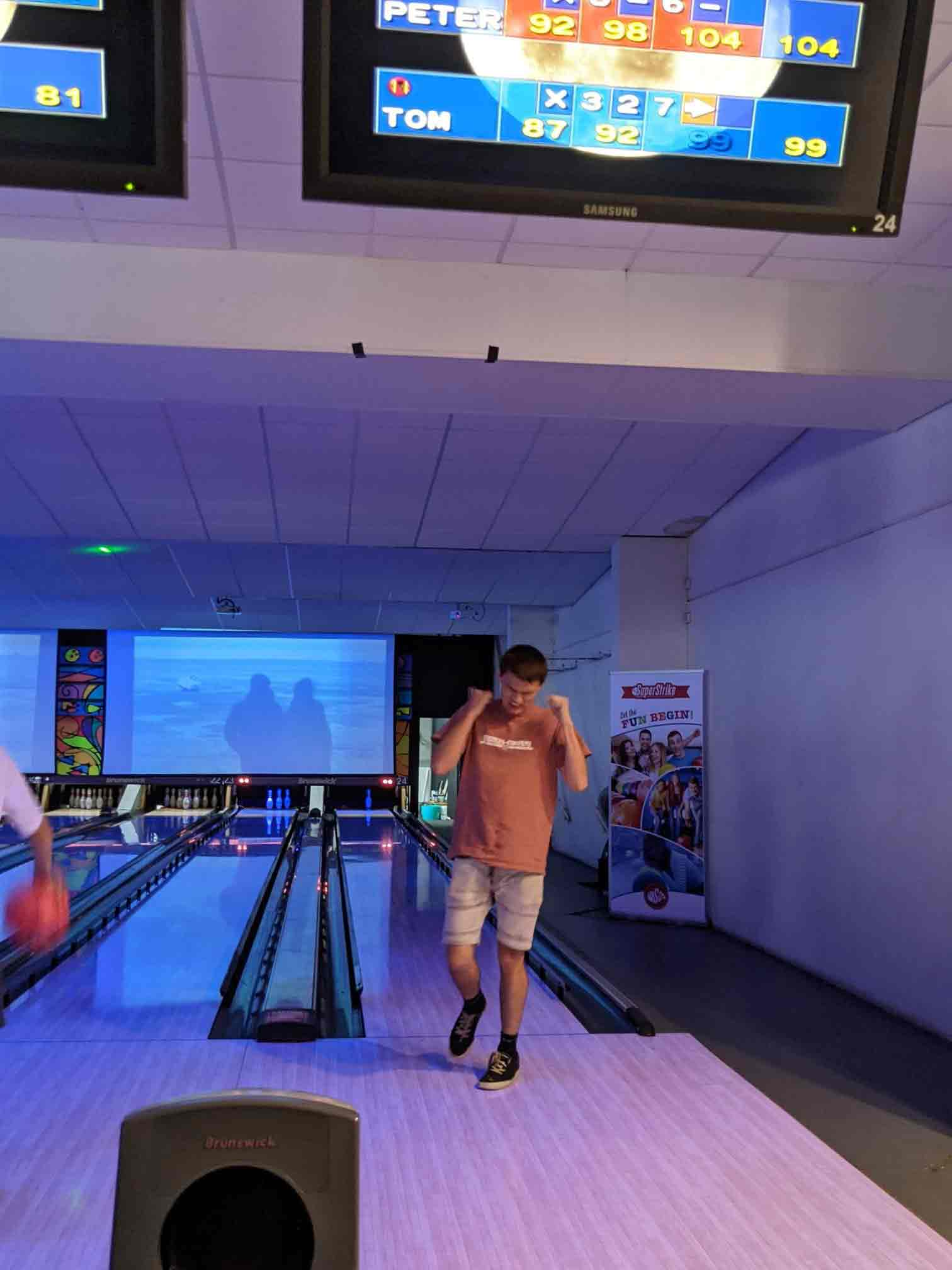 Thomas standing at the end of the bowling alley